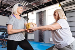 Cheerful aged women holding a ball Royalty Free Stock Photos