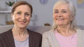 Cheerful aged women smiling at camera, dental implants, healthy teeth, care stock video