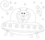 Cheerful alien in spaceship Stock Photos