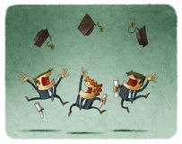 Cheerful alumni jumping with their cap in the air Stock Image