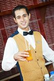 Cheerful arab barman Royalty Free Stock Image