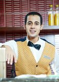 Cheerful arab barman Stock Image