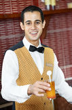 Cheerful arab barman Royalty Free Stock Photos