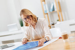 Cheerful architect drawing engineering scheme in the office Stock Images