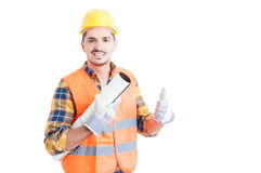 Cheerful architect holding a design paper work and thumb up Stock Image