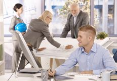 Cheerful architect team in office royalty free stock images