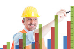 Cheerful architect writing on screen with charts royalty free stock image