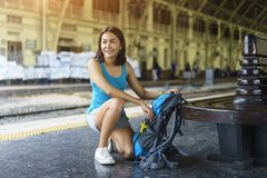 Cheerful Asia woman packing bag backpack for go to travel trip a stock images
