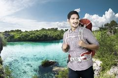 Cheerful asian backpacker enjoying nature Stock Images