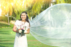 Cheerful asian bride. Outdoor portrait of a beautiful asian bride Stock Photos