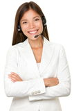 Cheerful Asian call operator Stock Photography