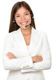Cheerful Asian call operator Stock Photography