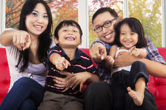 Cheerful asian family pointing at camera Royalty Free Stock Photography