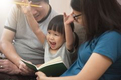Cheerful of Asian family with young father, mother and little kid girl. stock photos
