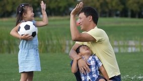 Happy father giving high five to little daughter stock footage