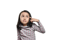Cheerful asian girl looking up thinking looking for idea or clue Royalty Free Stock Image