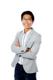 Cheerful asian man standing with arms folded Royalty Free Stock Photos