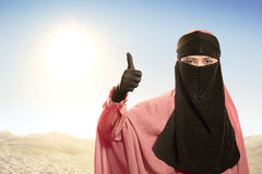 Cheerful asian muslim woman wearing hijab with good sign Stock Image