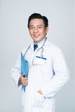 Cheerful Asian physician Stock Image