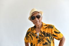 Cheerful asian senior old man, Confident and smiling elderly people with sunglasses in colorful hawaii shirt. royalty free stock image