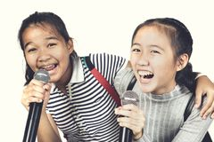 Cheerful asian teenager friend sing a song with happiness emoti. On stock images