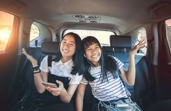 Cheerful asian teenager happiness emotion sitting in passenger c. Ar stock photography