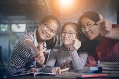 Cheerful asian teenager student relaxing in home living room stock photography