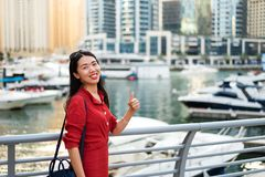 Cheerful Asian tourist in Dubai marina royalty free stock photography