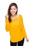 Cheerful asian woman hold clench Stock Photo