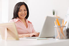 Cheerful asian woman looking at the photo frame Stock Photos