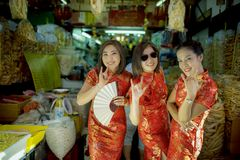 Cheerful asian woman wearing chinese tradition clothes toothy smiling face in bangkok china town royalty free stock photo