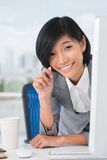 Cheerful assistant. Close-up of an office assistant smiling and looking at camera Stock Photography