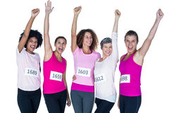 Cheerful athletes with arms raised Royalty Free Stock Images