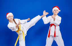 Cheerful athletes beat kick and point the finger super Stock Photography