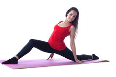Cheerful athletic girl posing on gymnastic mat Stock Photography