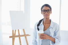 Cheerful attractive artist holding cup of coffee Stock Photography