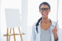 Cheerful attractive artist holding drawing pencil Stock Photo