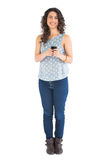 Cheerful attractive brunette texting Royalty Free Stock Photos