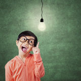 Cheerful attractive child pointing at lamp Royalty Free Stock Image