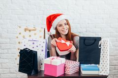 Cheerful attractive girl with presents posing to the camera. beauty, royalty free stock photo