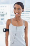 Cheerful attractive model in sportswear listening to music Stock Photo