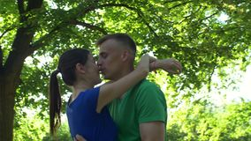 Happy couple in love embracing in public park stock video footage