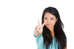 Cheerful attractive teenager showing peace sign Royalty Free Stock Image