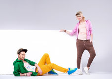 Cheerful teenagers in loose clothes Royalty Free Stock Image