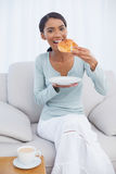 Cheerful attractive woman having a breakfast Royalty Free Stock Photos