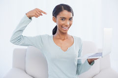 Cheerful attractive woman pointing at her laptop Royalty Free Stock Photography