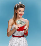 Cheerful attractive young lady holding cash and happy smiling. Shopping concept Royalty Free Stock Photo