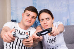 Cheerful and attractive young pair so passionated about the proc Stock Photography