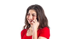 Cheerful attractive young sportswoman using mobile phone over white background royalty free stock images