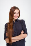 Cheerful attractive young woman standing with arms crossed Royalty Free Stock Images